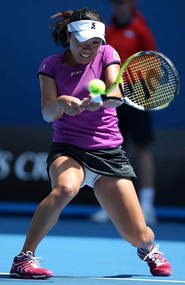 Kurumi Nara of Japan hits a backhand return to Jelena Jankovic of Serbia during their third round match at the Australian Open tennis championship in Melbourne, Australia, Saturday, Jan. 18, 2014
