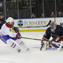New York Rangers goalie Henrik Lundqvist and right wing Mats Zuccarello (36) defend the net against a shot at goal by Montreal Canadiens right wing Brandon Prust (8) during the third period of an NHL hockey game Thursday, Jan. 29, 2015 at Madison Square Garden in New York. The Canadiens won 1-0. (AP Photo/Mary Altaffer)