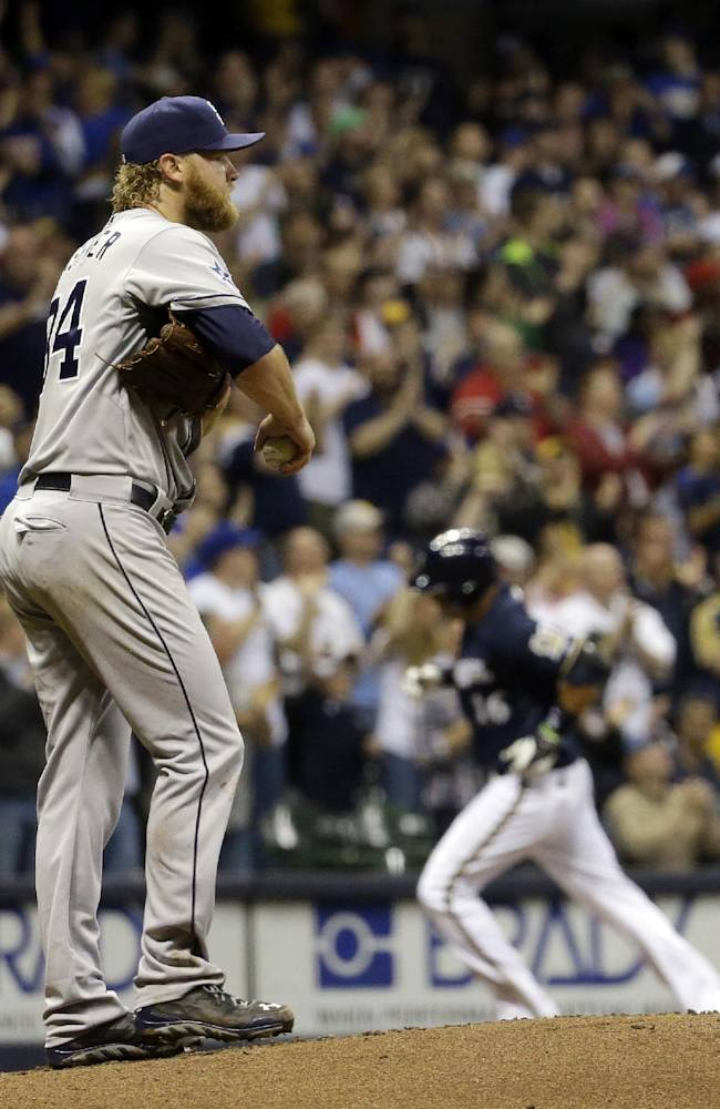 San Diego Padres starting pitcher Andrew Cashner walks back to the mound as Milwaukee Brewers' Aramis Ramirez rounds third after Ramirez hit a home run during the third inning of a baseball game Monday, April 21, 2014, in Milwaukee