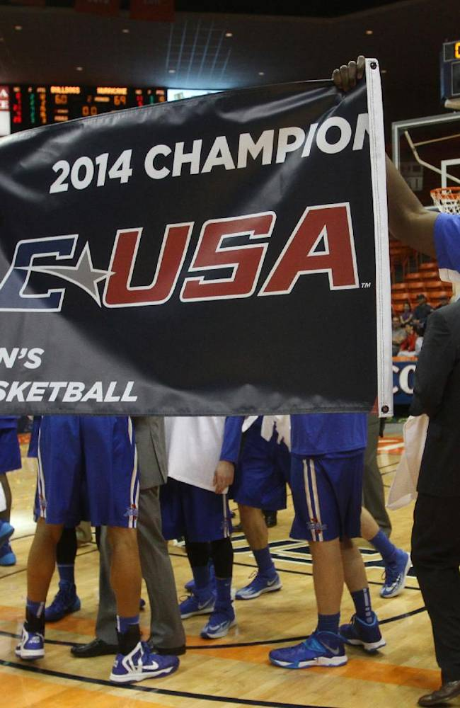 Tulsa players hold up a championship sign in celebratioin of their Conference USA Tournament championship game victory  over Louisiana Tech Saturday  March 15, 2014 in El Paso, Texas