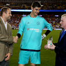 Kevin Fearns and Paul McLaughlin of Guinness present the Man of the Match trophy to FC Chelsea Thibaut Courtois (17)in action on Tuesday,July,28, 2015, in Landover, Maryland. Chelsea and FC Barcelona face off at the 2015 International Champions Cup. Damia