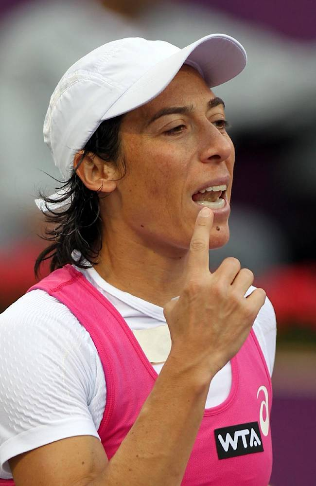 Francesca Schiavone of Italy reacts after losing a point against  Magdalena Rybarikova of Slovakia during the second day of the WTA Qatar Ladies Open in Doha, Qatar, Tuesday , Feb. 11, 2014