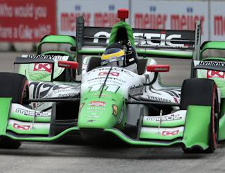 Sebastien Bourdais raises his fist after winning the second race of the IndyCar Detroit Grand Prix auto racing doubleheader in Detroit Sunday, May 31, 2015. (AP Photo/Dave Frechette)