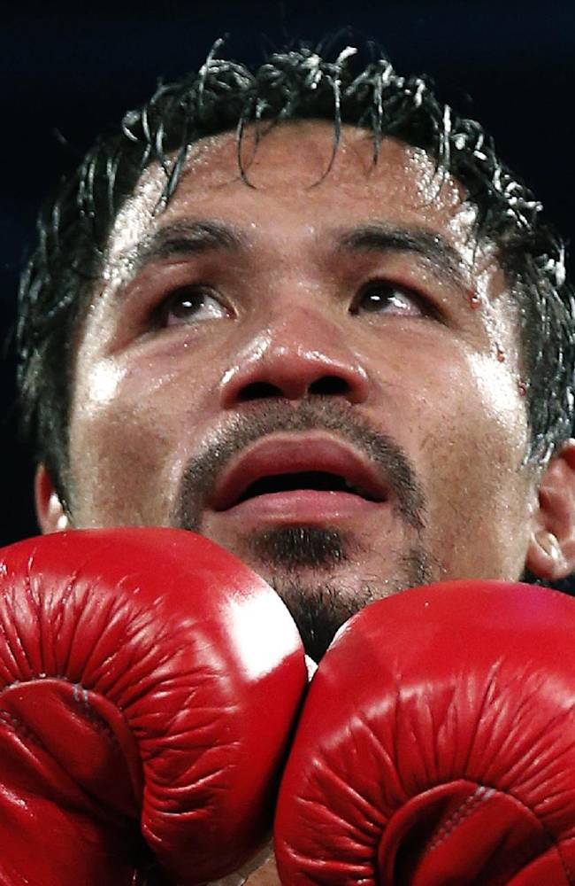 Pacquiao says he is borrowing to give typhoon aid