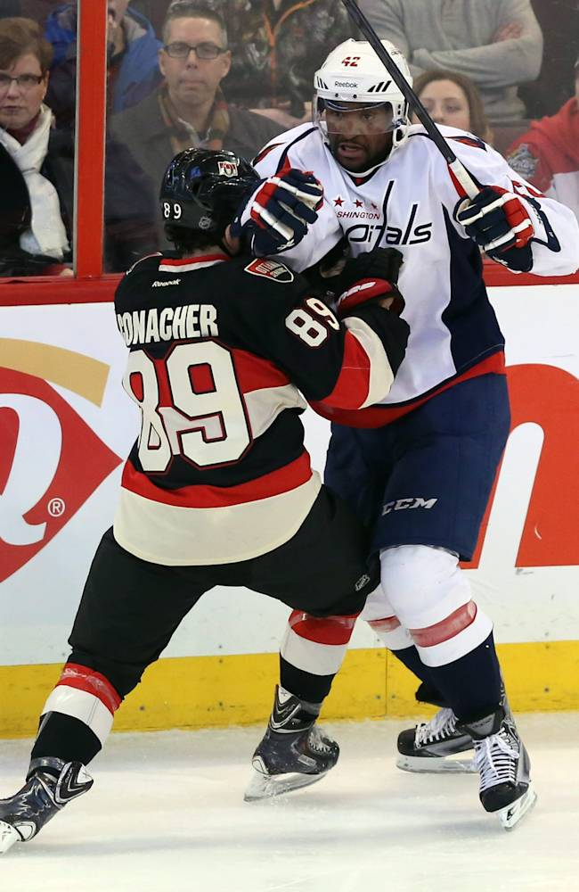 Ottawa Senators' Cory Conacher (89)collides with Washington Capitals' Joel Ward (42) during second period NHL hockey action in Ottawa, Ontario, on Monday, Dec. 30, 2013