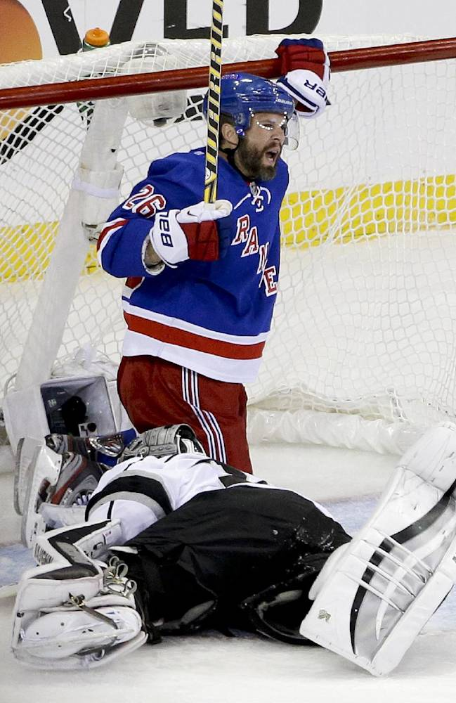 New York Rangers right wing Martin St. Louis (26) reacts after scoring against Los Angeles Kings goalie Jonathan Quick (32) in the second period during Game 4 of the NHL hockey Stanley Cup Final, Wednesday, June 11, 2014, in New York