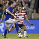 In this photo taken on July 5, 2013, the United States' Stuart Holden (11) defends against Guatemala's Jaime Carbajal during an international friendly soccer match in San Diego. Holden, who has fought a severe knee injury for two and a half years, finally got in a full 90 minutes for the first time since September 2011 when the United States beat Costa Rica 1-0 in a Gold Cup match on July 16. (AP Photo/Gregory Bull)