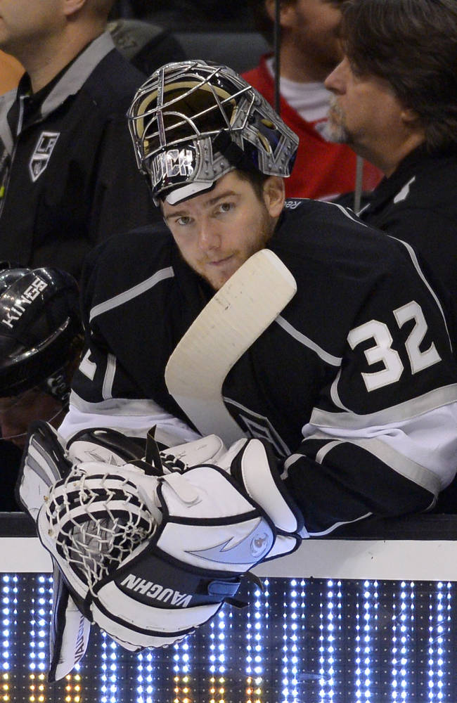 Los Angeles Kings goalie Jonathan Quick looks on from the bench after being pulled late in the game to ad an extra skater during the third period of an NHL hockey game against the Detroit Red Wings, Saturday, Jan. 11, 2014, in Los Angeles
