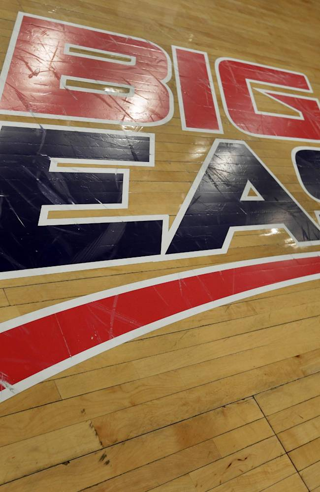 A Big East logo is displayed on the court at Madison Square Garden before an NCAA college basketball game between Marquette and St. John's, Saturday, March 9, 2013, in New York. The conference has reached an agreement with seven departing basketball members that will allow them to separate from the football schools and create their own conference on July 1. Commissioner Mike Aresco told The Associated Press on Friday the seven Catholic schools that are leaving to form a basketball-centric conference will get the Big East name, along with the opportunity to play their league tournament in Madison Square Garden