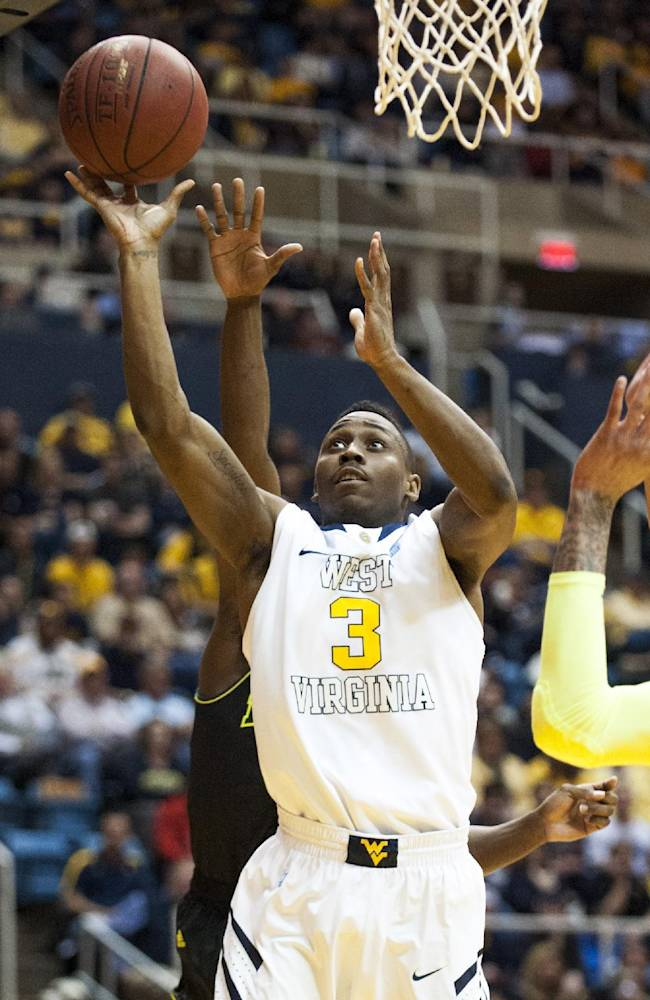 West Virginia's Juwan Staten (3) drives to the basket during the second half of an NCAA college basketball game against Baylor, Saturday, Feb. 22, 2014, in Morgantown, W.Va. Baylor won 88-75