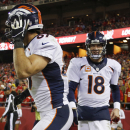 Denver Broncos quarterback Peyton Manning (18) congratulates wide receiver Eric Decker (87) for a touchdown reception during the second half of an NFL football game against the Kansas City Chiefs, Sunday, Dec. 1, 2013, in Kansas City, Mo. (AP Photo/Ed Zurga)