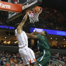 Virginia guard Malcolm Brogdon, left, dunks over Cleveland State forward Derek Sloan during the first half of an NCAA college basketball game in Charlottesville, Va., Thursday, Dec. 18, 2014. (AP Photo/Steve Helber)