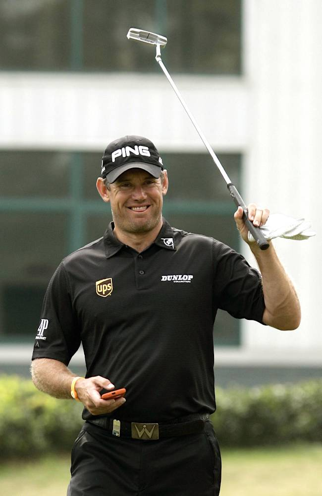 Lee Westwood of England gestures at the 4th hole during the Pro-Am event of the HSBC Champions golf tournament, which begins on Thursday, at the Sheshan International Golf Club in Shanghai, China, Wednesday, Oct. 30, 2013.  (AP Photo)
