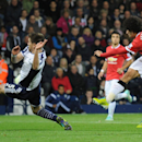 Manchester United's Marouane Fellaini, right, scores against West Brom during the English Premier League soccer match between West Bromwich Albion and Manchester United at the Hawthorns, Birmingham, England, Monday, Oct. 20, 2014