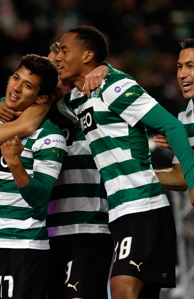 Sporting's Montero, from Colombia, 2nd left, celebrates after scoring their second goal against Pacos de Ferreira  during their Portuguese league soccer match Sunday, Dec. 1, 2013, at Sporting's Alvalade stadium in Lisbon