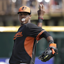 Baltimore Orioles third baseman Michael Almanzar warms up for batting practice during a spring exhibition baseball game against the Pittsburgh Pirates in Bradenton, Fla., Monday, March 10, 2014 The Associated Press