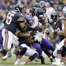 Minnesota Vikings receiver Greg Jennings (15) is tackled by Chicago Bears defenders during the second half of an NFL football game Sunday, Nov. 16, 2014 in Chicago The Associated Press