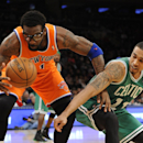 Boston Celtics' Courtney Lee (11) knocks the ball loose from New York Knicks' Amar'e Stoudemire (1) during the first half of an NBA basketball game on Sunday, Dec. 8, 2013, in New York. The Celtics won 114-73 The Associated Press