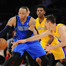 Dallas Mavericks forward Shawn Marion, left, and Los Angeles Lakers guard Steve Nash, right, vie for a loose ball during the first half of an NBA basketball game, Friday, April 4, 2014, in Los Angeles The Associated Press