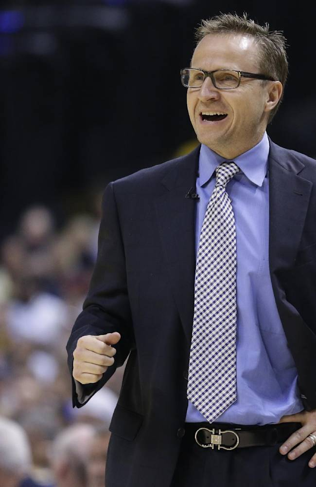 Oklahoma City Thunder head coach Scott Brooks yells to his team as they play against the Indiana Pacers in the second half of an NBA basketball game in Indianapolis, Sunday, April 13, 2014. The Pacers defeated the Thunder 102-97