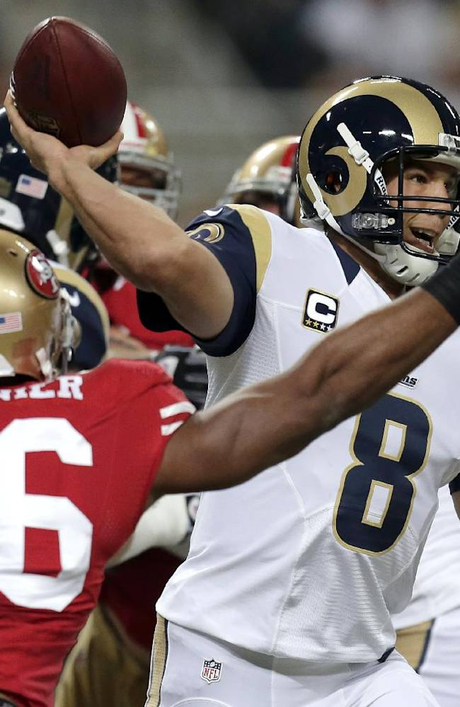 St. Louis Rams quarterback Sam Bradford (8) throws under pressure form San Francisco 49ers linebacker Corey Lemonier (96) during the first quarter of an NFL football game Thursday, Sept. 26, 2013, in St. Louis
