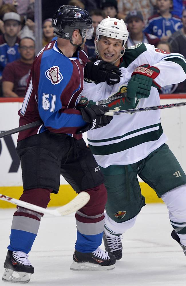 Minnesota Wild center Cody McCormick (8) fights to get around Colorado Avalanche defenseman Andre Benoit (61) during the first period in Game 1 of an NHL hockey first-round playoff series on Thursday, April 17, 2014, in Denver
