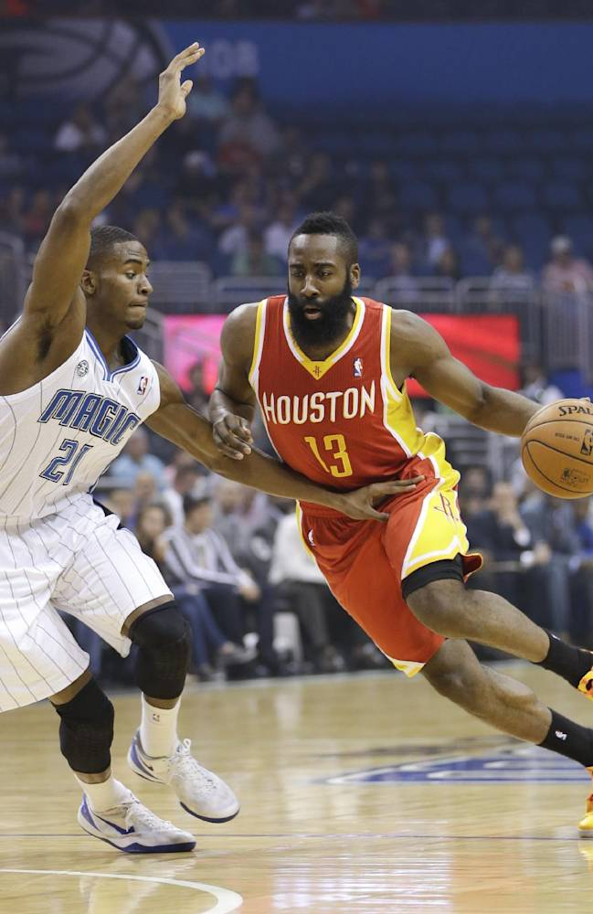 Houston Rockets' James Harden (13) drives around Orlando Magic's Maurice Harkless (21) during the first half of an NBA basketball game in Orlando, Fla., Wednesday, March 5, 2014