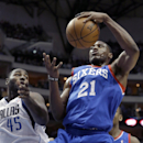 Philadelphia 76ers forward Thaddeus Young (21) pulls in a rebound against Dallas Mavericks center DeJuan Blair (45) during the first half of an NBA basketball game in Dallas, Monday, Nov. 18, 2013 The Associated Press