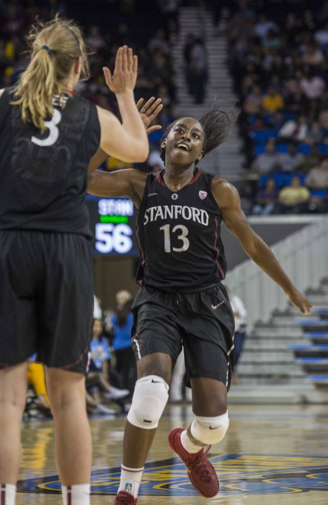 Stanford forward Chiney Ogwumike, right, who scored a game-high 26 points, celebrates with her teammate Mikaela Ruef, right, after scoring in the second half of an NCAA college basketball game, Sunday, Feb. 23, 2014 in Los Angeles. Stanford won 65-54