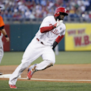 Philadelphia Phillies' Tony Gwynn, Jr. rounds third to score from second on an RBI-single by Jimmy Rollins during the first inning of a baseball game against the Miami Marlins, Saturday, April 12, 2014, in Philadelphia The Associated Press