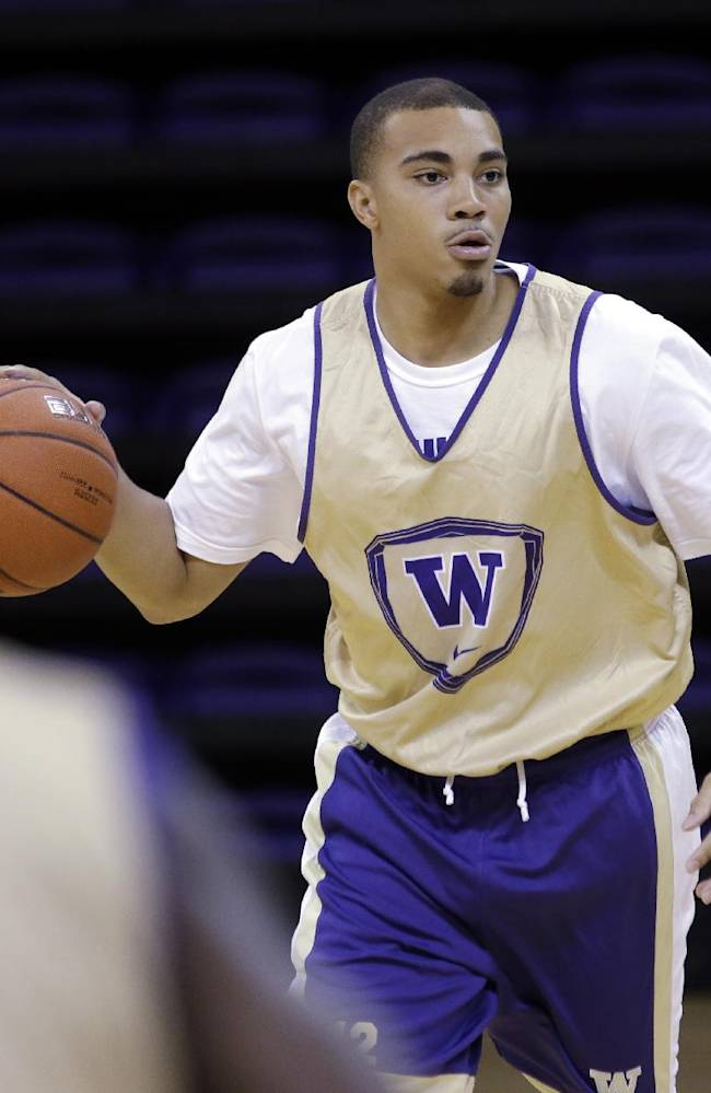 Washington's Andrew Andrews dribbles during the NCAA college basketball team's practice Tuesday, Oct. 8, 2013, in Seattle