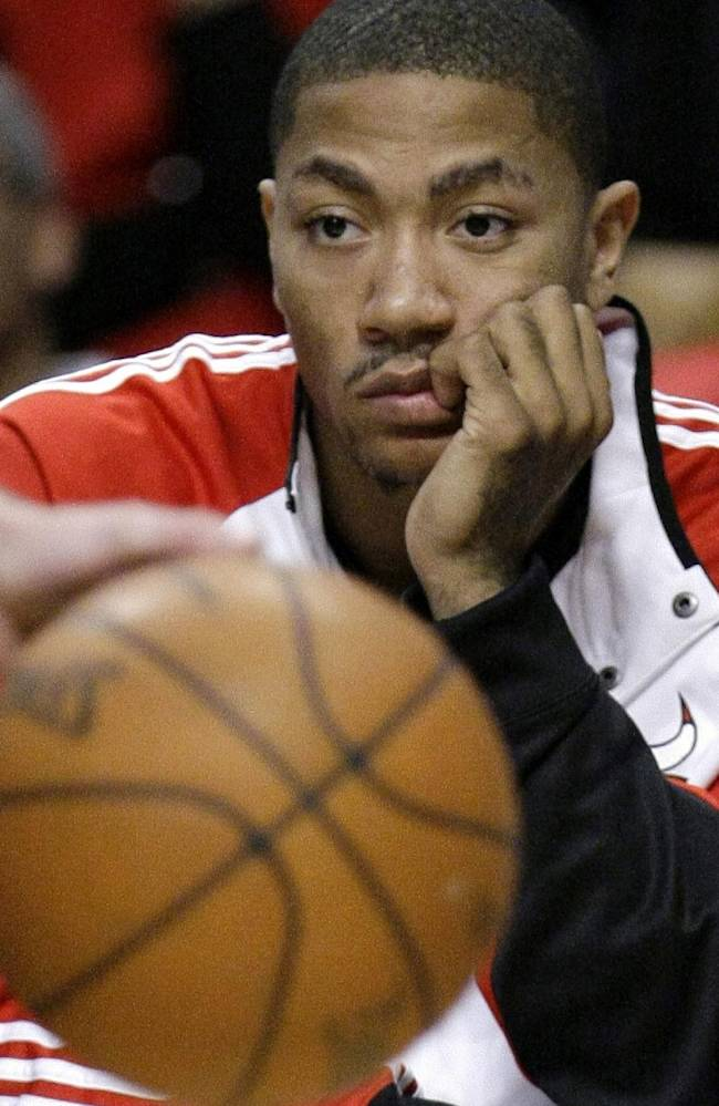 In this Oct. 19, 2009, file photo, Chicago Bulls' Derrick Rose sits on the bench watching his team during the fourth quarter of their preseason NBA basketball game and 101-98 loss to the Orlando Magic. Rose is out for the season. The team said Monday, Nov. 25, 2013, that Rose had successful surgery to repair a torn medial meniscus in his right knee.  Rose was hurt Friday night at Portland