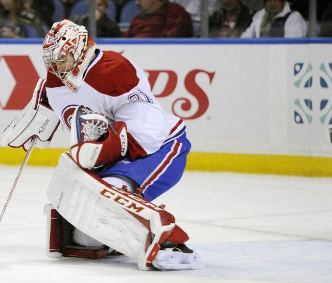 Montreal Canadiens goaltender Carey Price stands in front of the net as the puck hits the goal post during the first period of an NHL hockey game against the Buffalo Sabres in Buffalo, N.Y., Wednesday, Nov. 27, 2013