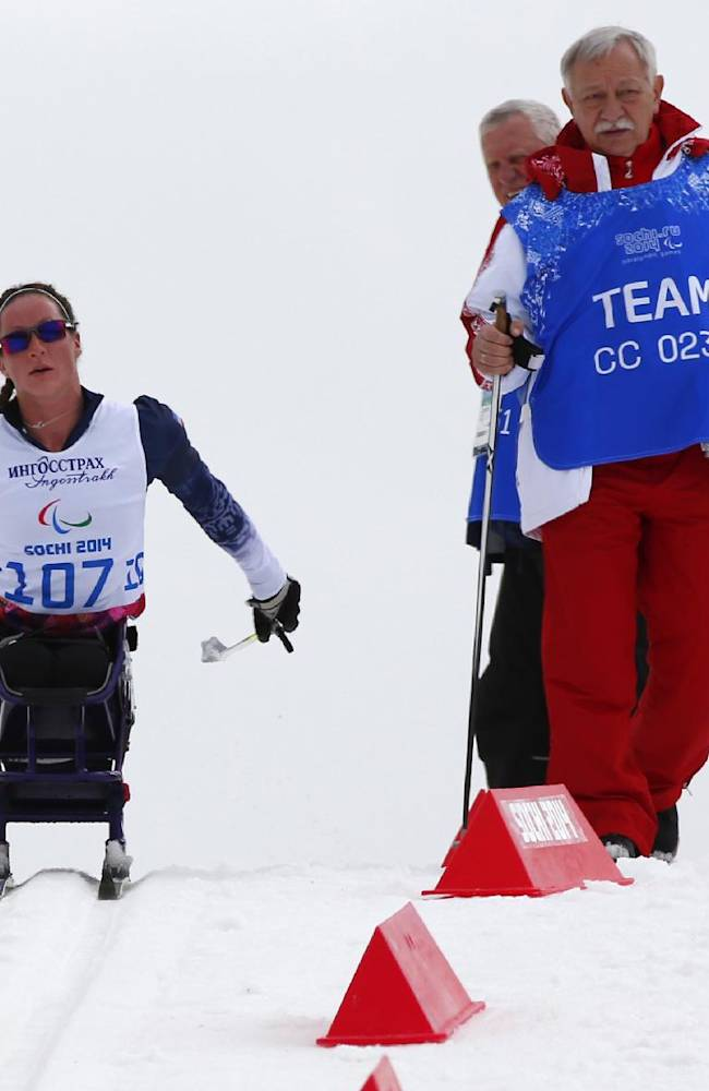 Tatyana Mcfadden of United States races during the ladies 12km cross country ski, sitting event at the 2014 Winter Paralympic, Sunday, March 9, 2014, in Krasnaya Polyana, Russia
