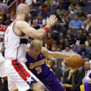 Los Angeles Lakers guard Steve Blake (5) runs into Washington Wizards center Marcin Gortat (4), from Poland, in the first half of an NBA basketball game Tuesday, Nov. 26, 2013, in Washington The Associated Press