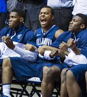 Villanova's Tony Chennault, second from left, ce;ebrates after teammate JayVaughn Pinkston (22) hits a free-throw late in the overtime of an NCAA college basketball game, Tuesday, Dec. 31, 2013, in Indianapolis. Villanova won 76-73. (AP Photo/Doug McSchooler)