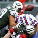 New York Jets quarterback Michael Vick (1) is sacked by Buffalo Bills' Mario Williams (94) and Kyle Williams (95) during the first half of an NFL football game Sunday, Oct. 26, 2014, in East Rutherford The Associated Press