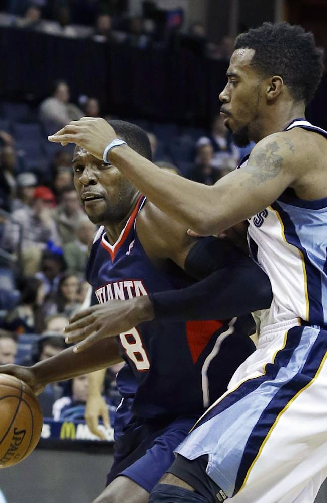 Memphis Grizzlies' Mike Conley, right, defends against Atlanta Hawks' Shelvin Mack (8) in the first half of an NBA basketball game in Memphis, Tenn., Sunday, Jan. 12, 2014