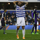 QPR's Charlie Austin holds his head after a missed opportunity during the English Premier League soccer match between Queens Park Rangers and Manchester City at Loftus Road stadium in London, Saturday, Nov. 8, 2014