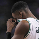 Boston Celtics forward Jeff Green (8) rubs his eye after taking a hit to the face on a drive to the basket against the Philadelphia 76ers during the second quarter of an NBA basketball game Friday, April 4, 2014, in Boston The Associated Press