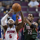 Detroit Pistons forward Josh Smith (6) beats Milwaukee Bucks forward Khris Middleton (22) to a rebound during the second half of an NBA basketball game Monday, March 31, 2014, in Auburn Hills, Mich. Smith scored 26 points to help the Pistons to a 116-111