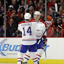 Montreal Canadiens defenseman Sergei Gonchar (55), right, celebrates with center Tomas Plekanec (14) after scoring his goal during the second period of an NHL hockey game against the Chicago Blackhawks in Chicago, Friday, Dec. 5, 2014 The Associated Press