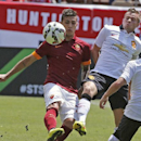 Manchester United's Tom Cleverley, second from right, battles with AS Roma's Leandro Paredes, left, during an exhibition soccer match at Mile High Stadium in Denver, Saturday, July 26, 2014. Manchester United won 3-2