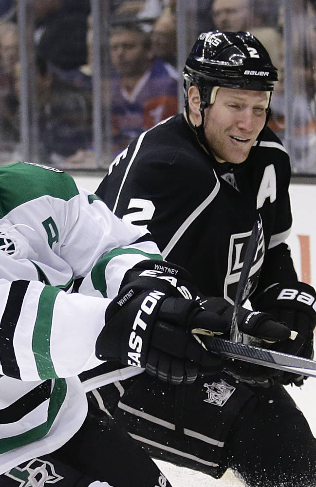 Dallas Stars' Ray Whitney, left, skates past Los Angeles Kings' Matt Greene during the first period of an NHL hockey game on Monday, Dec. 23, 2013, in Los Angeles