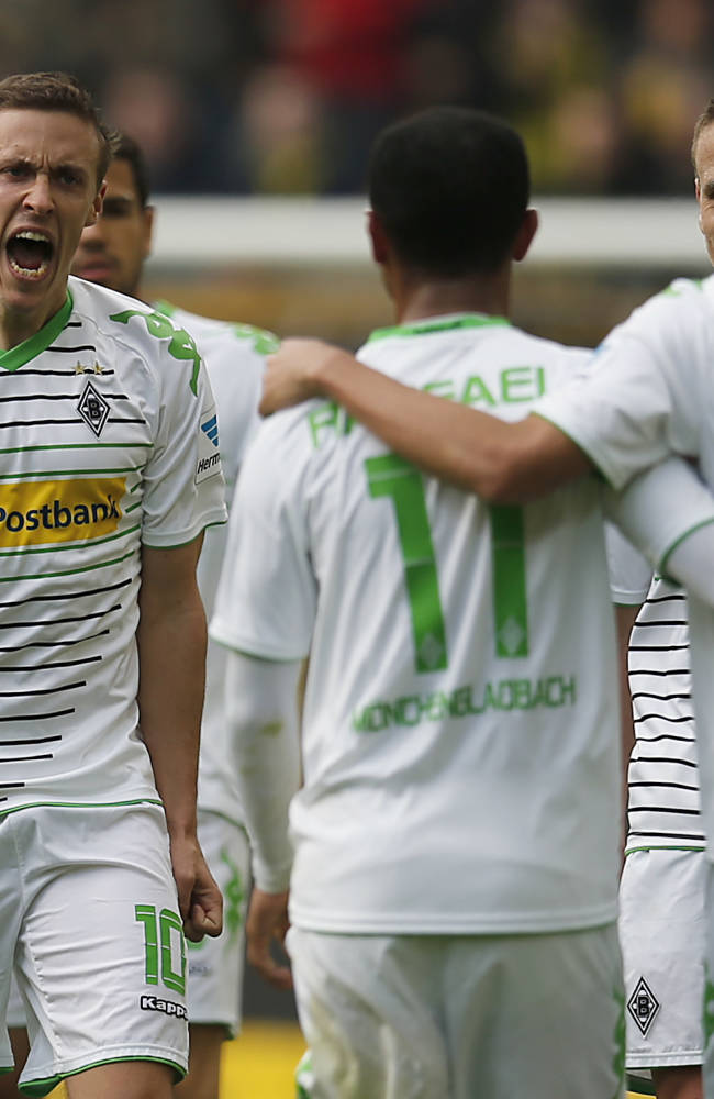 Moenchengladbach's Max Kruse, second from left, celebrates with teammates after scoring  during the German first division Bundesliga soccer match between BvB Borussia Dortmund  and VfL Borussia Moenchengladbach in Dortmund, Germany, Saturday, March 15, 2014