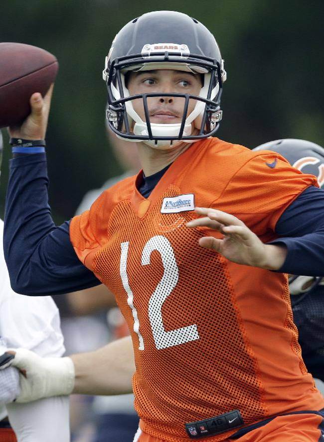 Chicago Bears quarterback David Fales (12) looks to pass during team's NFL football training camp at Olivet Nazarene University on Saturday, July 26, 2014, in Bourbonnais, Ill