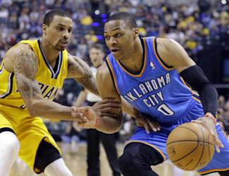 Oklahoma City Thunder guard Russell Westbrook, right, drives against Indiana Pacers guard George Hill in the second half of an NBA basketball game in Indianapolis, Sunday, April 13, 2014. (AP Photo/Michael Conroy)