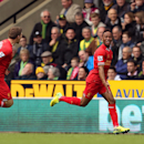 Liverpool's Raheem Sterling, right, celebrates scoring the opening goal during their English Premier League match against Norwich City at Carrow Road, Norwich, eastern England, Sunday April 20, 2014. (AP Photo/PA, Chris Radburn) UNITED KINGDOM OUT NO SALE