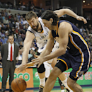 Memphis Grizzlies center Marc Gasol, back, of Spain, scrambles for a loose ball against Indiana Pacers forward Luis Scola (4), of Argentina, in the second half of an NBA basketball game on Saturday, March 22, 2014, in Memphis, Tenn. The Grizzlies won 82-7