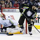 Team Foligno's Nick Foligno (71) of the Columbus Blue Jackets tries a backhand behind the back shot in front of Team Toews' goalie Roberto Luongo of the Florida Panthers during the first period NHL All-Star hockey game in Columbus, Ohio, Sunday, Jan. 25,